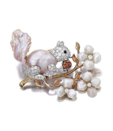 A cultured freshwater pearl, diamond and colored diamond brooch, Ruser designed as a cultured pink freshwater pearl squirrel, enhanced by pavé-set diamonds and onyx cabochon eye, holding a brown diamond, perched on a textured gold branch, extending cultured freshwater pearl and diamond flowers; signed Ruser, estimated total diamond weight: 2.40 carats; mounted in platinum and eighteen karat gold plated platinum.