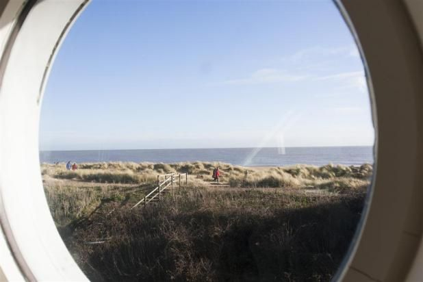Through the round window at Ferryway in Southwold.