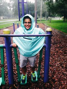 Playing at the park wearing Roo Rain Gear rain wear made from RPET