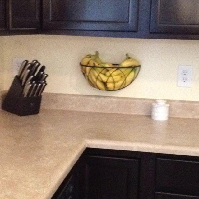 Hanging planter basket re-purposed as a fruit holder