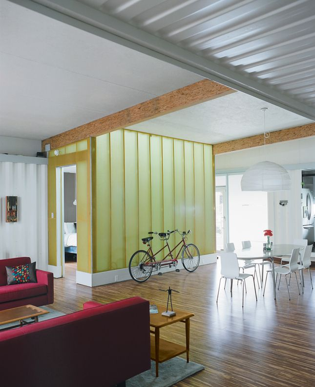This a shipping container house, which not only reduces the cost of construction but results in a modern esthetic.