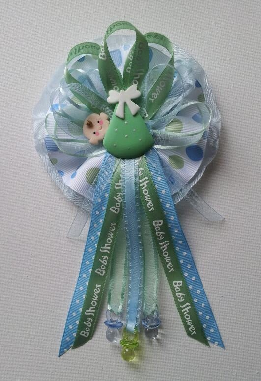 mommy baby shower corsage with baby in green swaddle baby shower