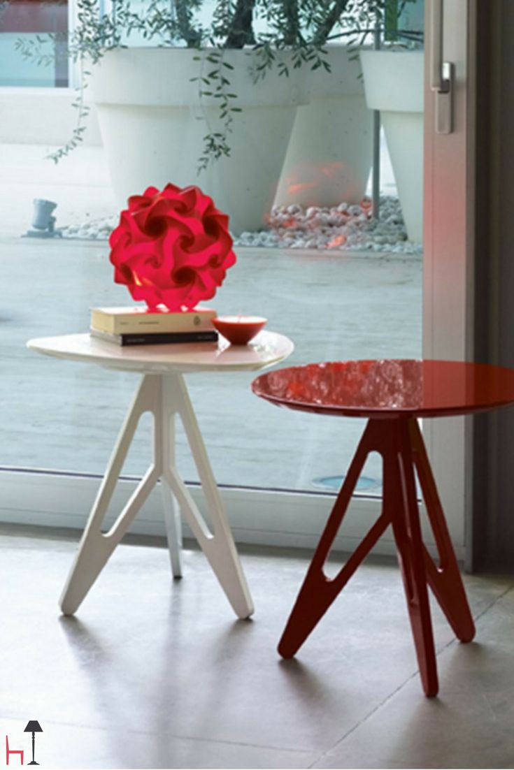 Easy by Linfa Design is a coffee table lacquered in a glossy white shade, with a shield-shaped top.