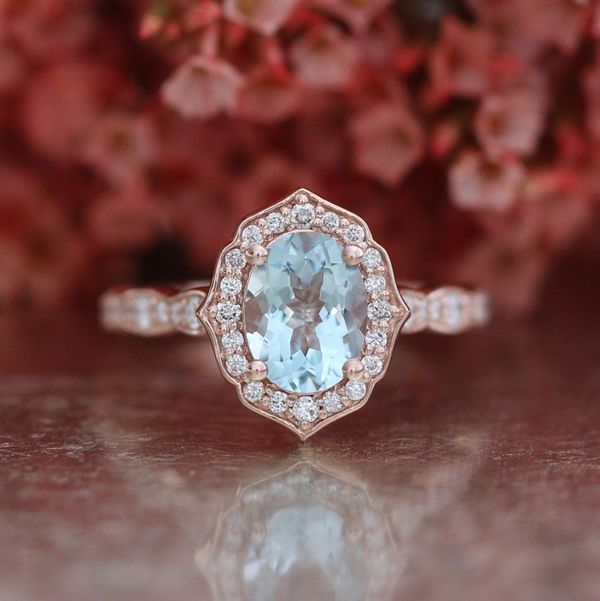 Vintage aquamarine engagement ring with scalloped rose gold band.
