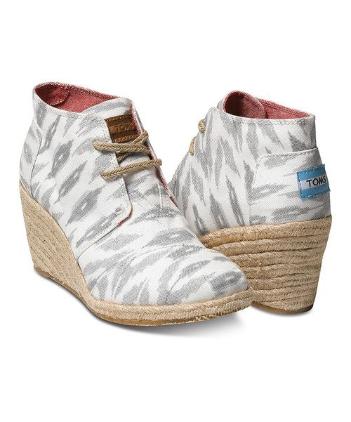 Buy Toms now on Zulily for kids and adults at 30% off! A bootie with a bit of lift, this wedge was designed with walkability in mind. With your purchase, TOMS will give a pair of new shoes to a child in need. One for One.® Size note: TOMS run true to size. If you're typically in-between sizes, TOMS recommends ordering smaller since TOMS shoes will stretch with wear.