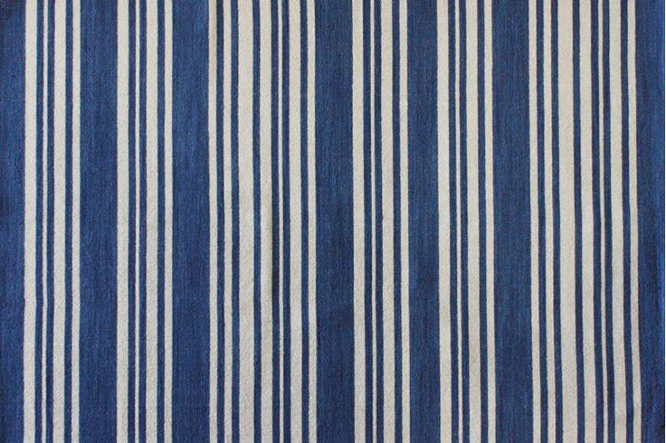The Newport Blue Stripe Floor Rug offers a refreshing blue stripe pattern to brighten your living room by adding that extra special touch.
