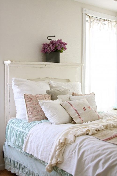 Use a salvaged wood mantel as a headboard - cool idea! Think about it, you may even get a shelf too.