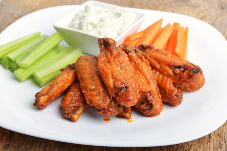 Turn your house into game-day headquarters with these fan-favorite finger foods and snacks.  1. Restaurant-Style Buffalo Chicken Wingskitchme.comNo need to o