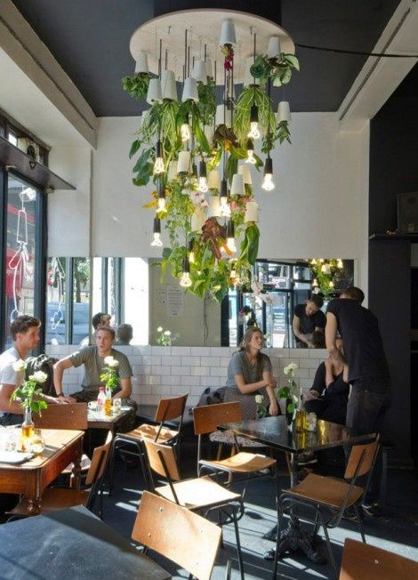 How amazing is this hanging garden chandelier?? Fantastic interior design for a cafe!