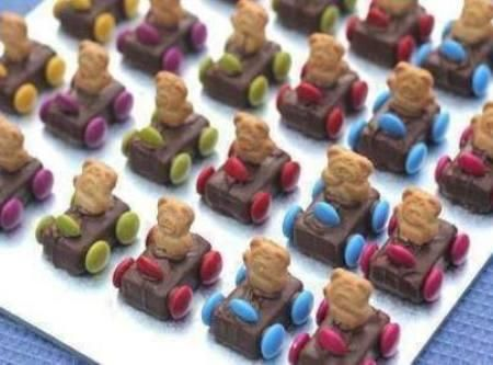Teddy Bear Race Cars Treat Recipe--use a knife to make a slit to fit the teddy graham in the candy bar.  Makes things go easier.  Very cute and popular for the Daytona 500 party.