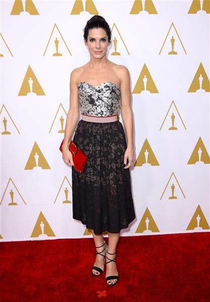 Sandra Bullock arrives at the 86th annual Oscars Nominees Luncheon in Beverly Hills, Calif., on Feb. 10, 2014.