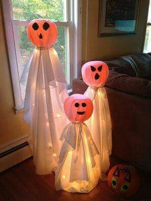 Put a PLASTIC PUMPKIN BUCKET on top of a TOMATO CAGE decorate cage with lights and drape a SHEET over it and tie twine around neck....love this!!