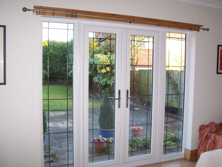 Stunning French doors with a bespoke glass design. http://www.finesse-windows.co.uk/french_doors.php
