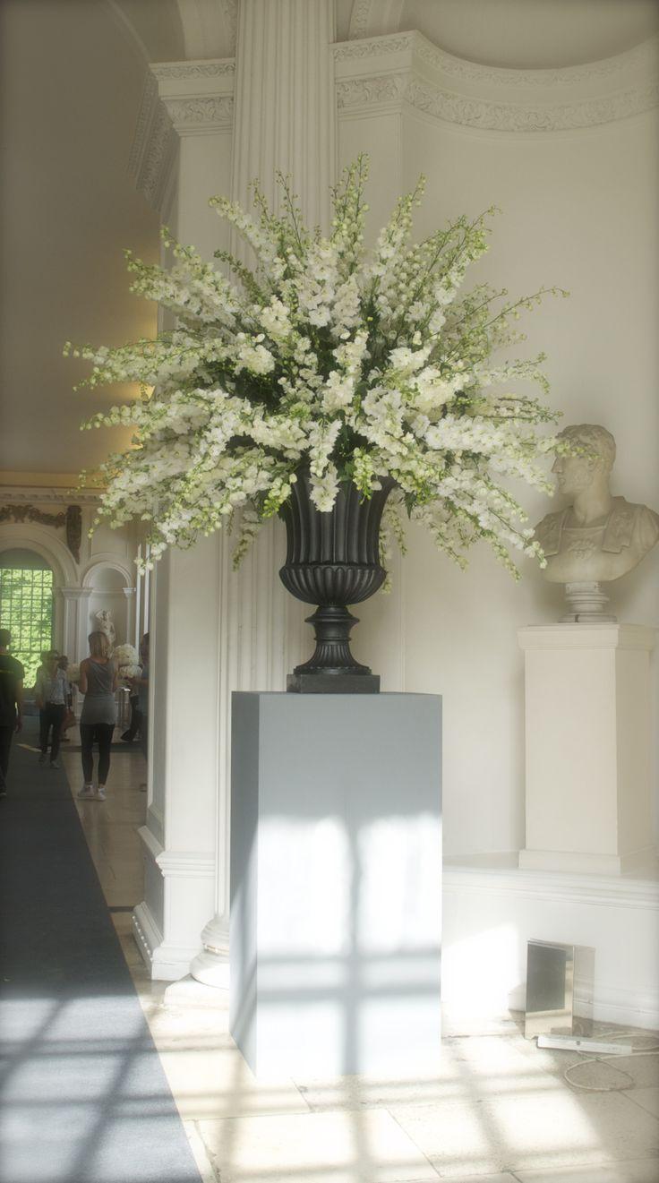 Urns of white delphinium