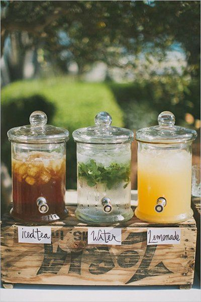 This line-up of refreshing summer drinks have our mouths watering for the sweet taste of summer. A station of beverage dispensers adds a quaint touch.Related:Signature Cocktails for Summer Weddings