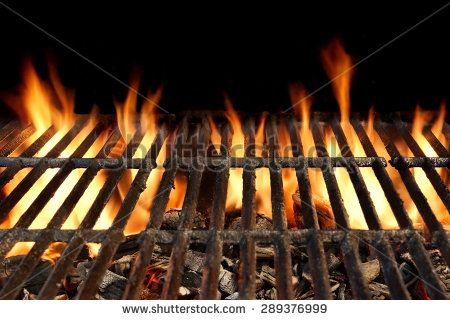 Close-up Of BBQ Grill With Flaming Charcoal Isolated On Black Background - stock photo