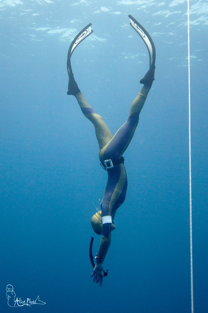 Freediving in Red Sea, constant weight training, safety freediver Yulia Maryevich on her descent