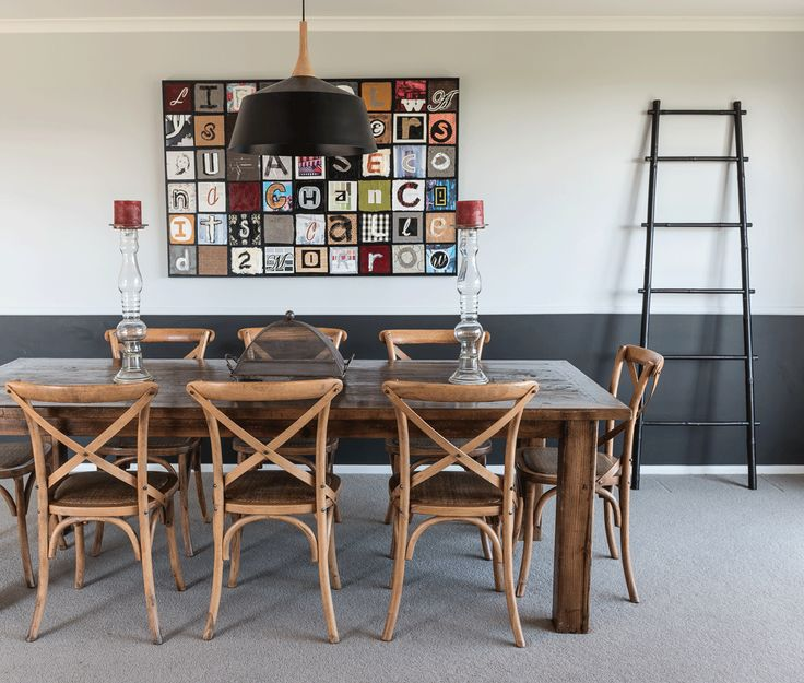 To add visual interest to the long open-plan dining room and kitchen, the walls were half painted in Resene Bokara Grey (below) and Resene Half Silver Chalice. Jessica used her graphic design background to create the hanging artwork.