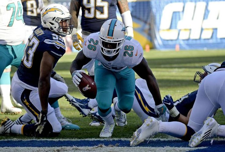 Dolphins vs. Chargers:  31-24, Dolphins  -  November 13, 2016  -    Miami Dolphins running back Damien Williams scores against the San Diego Chargers during the second half of an NFL football game in San Diego on Nov. 13, 2016.  Denis Poroy AP