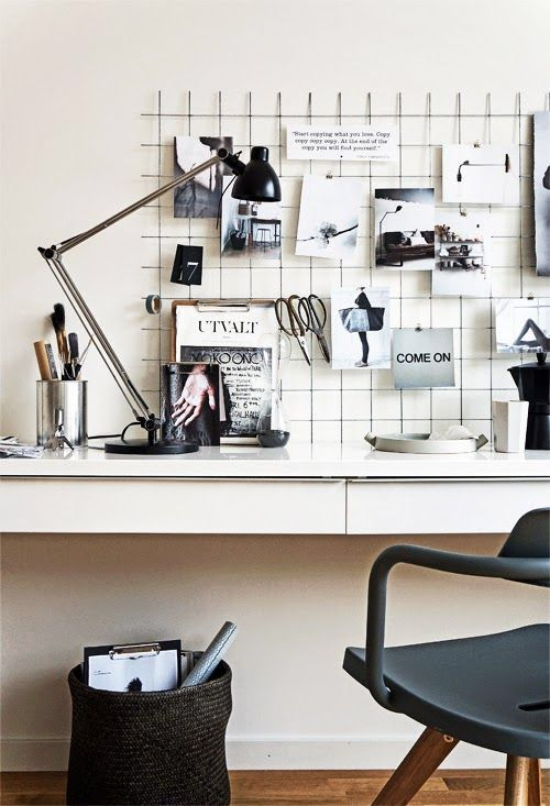 The wire mesh definitely adds functionality and style to this chic workspace design.
