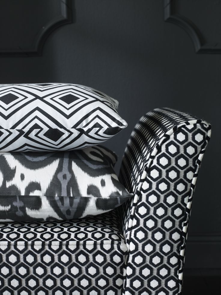 """Simply striking graphics here! -- Machine translation: """"Decorate with Pillows and Fabric"""" -- """"Graphically patterned pillows. Ikatmönstrad pillow. Pierre & Peter's, and the top of a pillow with diamonds, Medelpadsgatan, Oscar & Clothilde."""""""