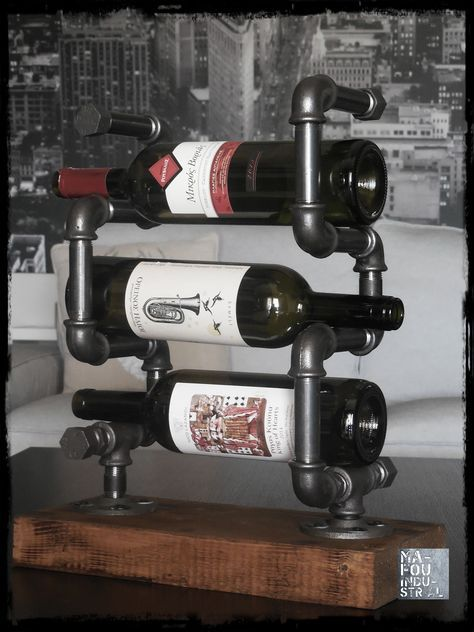Industrial wine bottle display made of black fittings and pipes and wooden base