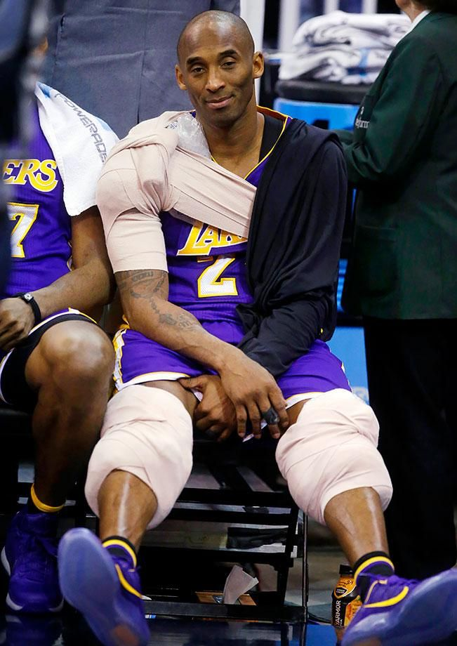 Los Angeles Lakers forward Kobe Bryant sits on the bench after coming out of the game during the second half against the Utah Jazz in Salt Lake City.