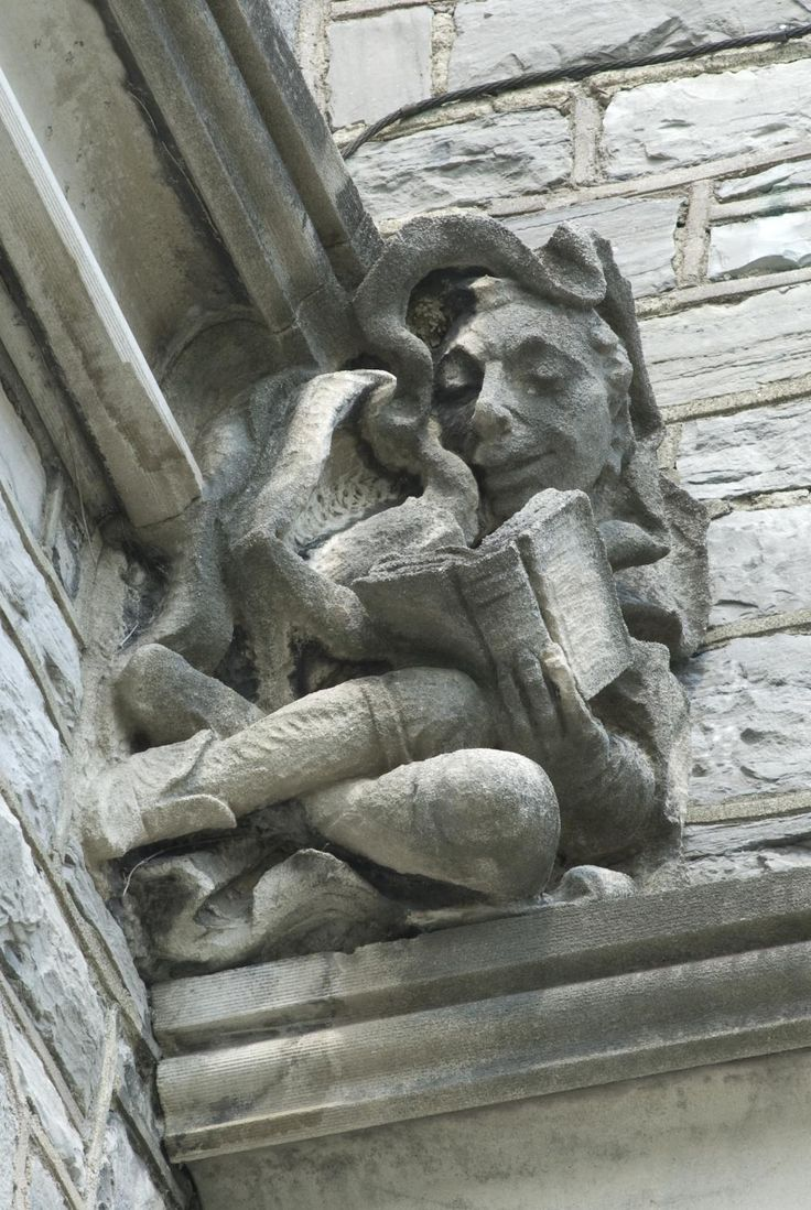 Gargoyle reading a book