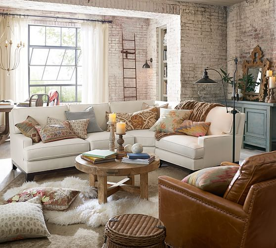 The brick walls leave us totally  - love the mix of textures and styles in this urban chic space!