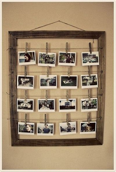 Display many photos with an old frame, wire, and clothespins.  PERFECT use for the huge frame I just took apart for the girls hair bow holder!!!
