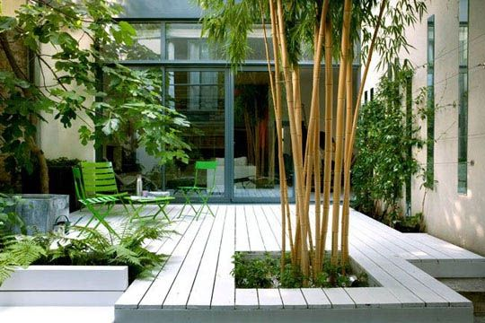 Steel - white decking - Bamboo. Really good use of vertical & horizontal straight lines. Limited colour palette of grey, white & green makes this a very sophisticated space