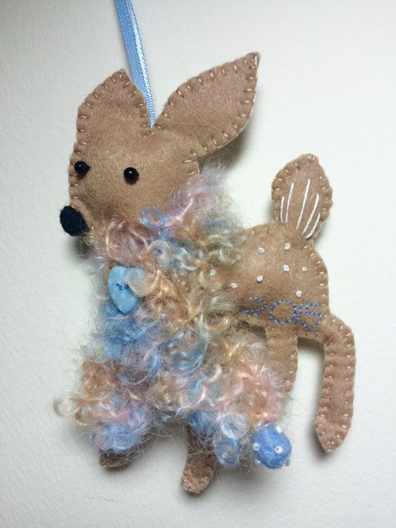 Finlay the fawn Christmas decoration. Finlay is new for 2015 and will be part of this year's limited edition felt decoration collectibles.  He has a handknitted scarf in curly mohair from Maggi Knits, one of my favourite yarn companies.