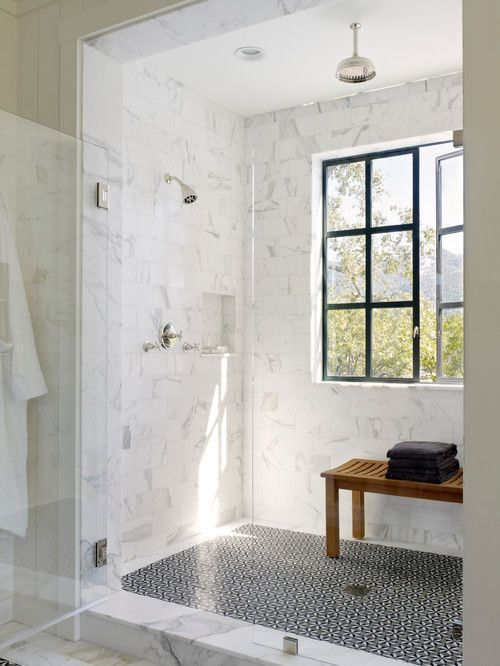 large shower, waterfall showerhead, marble tile