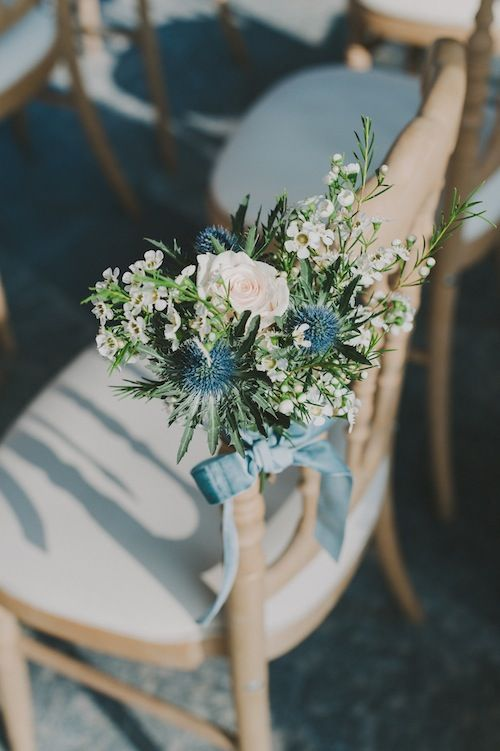 wedding chair bouquets tied with powder blue velvet ribbon