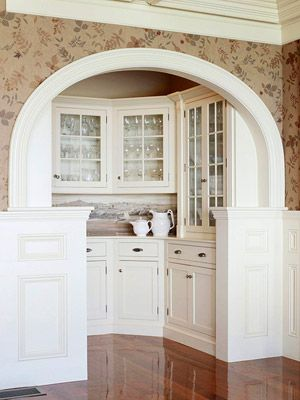 A butlers pantry!  Some of my friends have a butlers pantry in their homes. I have serious butlers pantry envy!  And I love this one with the welcoming archway!