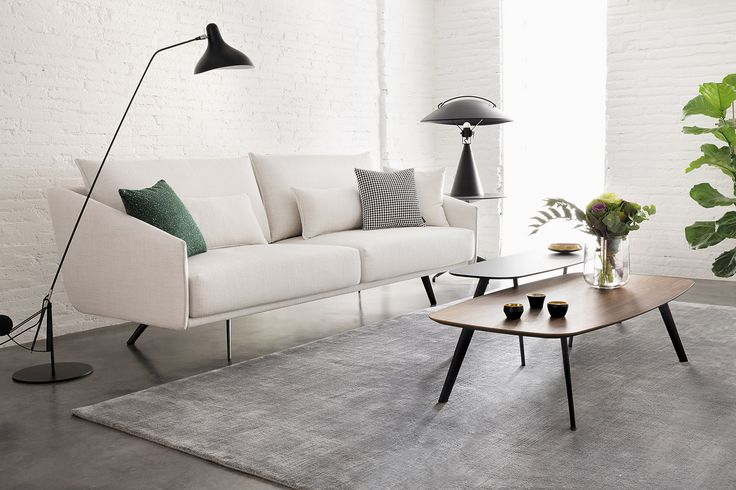 """Costura sofa design refers to the noble tradition of tailoring that has guided the design process"". Jon Gasca. Here shown with Solapa tables, created to match the sofa. COSTURA: www.stua.com/design/costura SOLAPA: www.stua.com/design/solapa USA: www.dwr.com/stua Instagram: @stuadesign"
