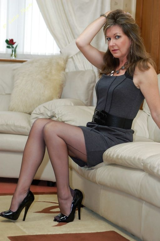 Mature in stocking and high heels