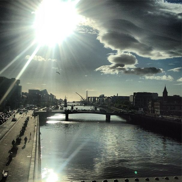 Beautiful photo of sun fighting against rain clouds over the River Liffey in Dublin City. Taken August 20, 2012 at 09.45am
