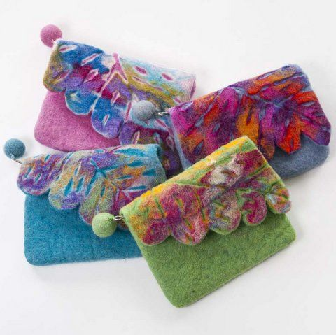Handmade, one-of-a-kind, felted leaf coin purses with a cutout leaf design on fold over flap. Our skilled artisans create this design by nuno felting layers of different color wool and cut out a leaf