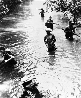 Vietnam soldiers under the command of a French corporal wade through a swollen creek in the area of the 'military capital' of the Viet Minh, Thai Nguyen. October 1950 - pin by Paolo Marzioli