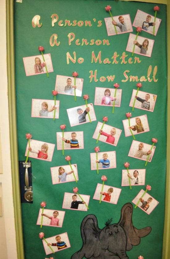 CUTE bulletin board idea! Maybe they could hold out a frame to hold their artwork?