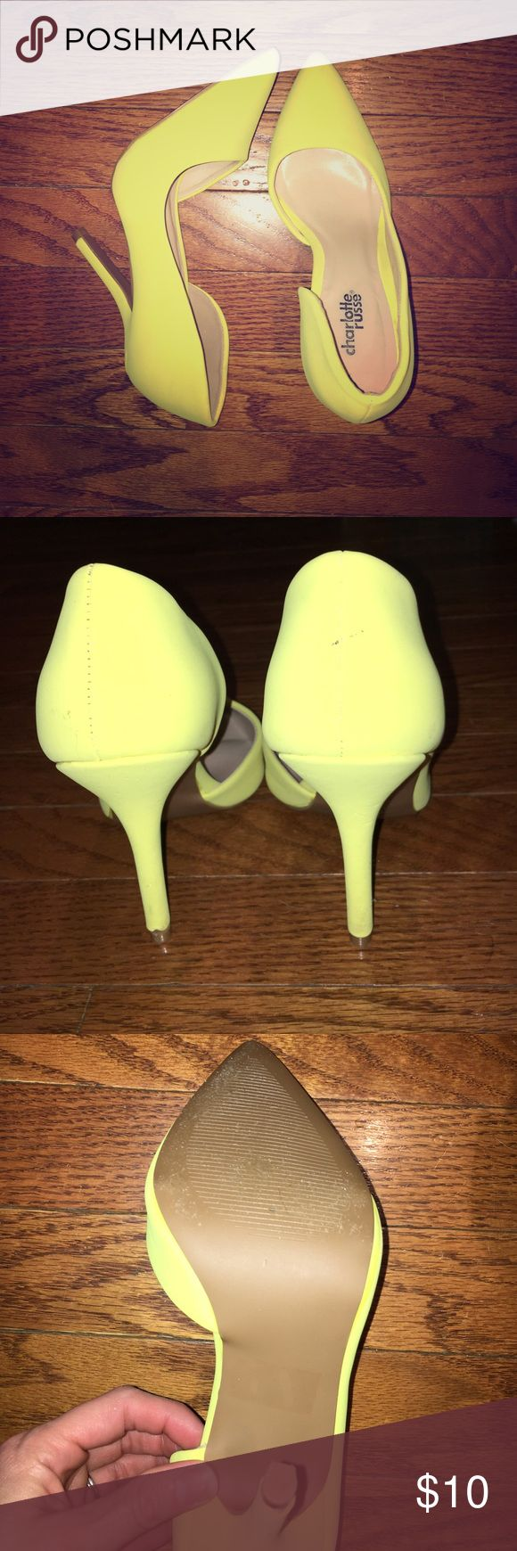 "Charlotte Russe neon high heeled pumps Fun and sexy bright neon yellow high heeled pumps. These have been worn a few times and do have some wear a couple scuffs but nothing noticeable when wearing them. Size 7 high height approximately between 4"" - 4 1/2"" Charlotte Russe Shoes Heels"