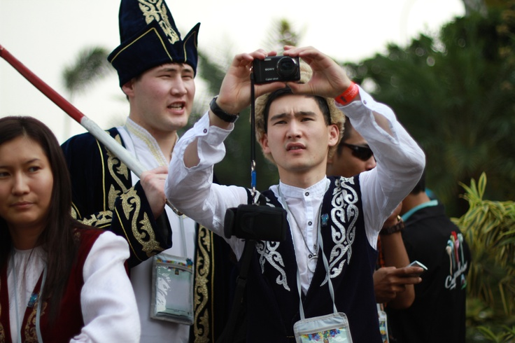 Traditional costumes, modern day technology. Awesome!