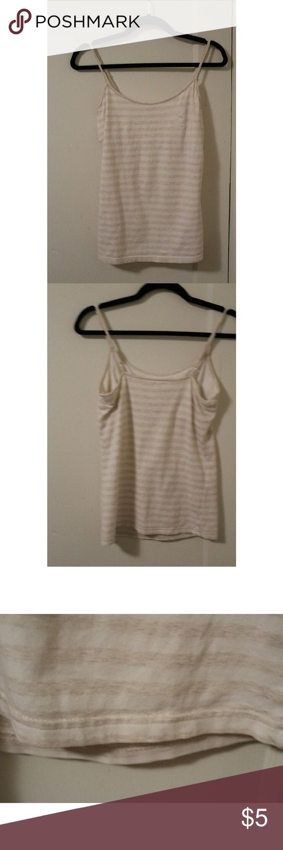 Gap Cami This cream and white striped cami features a built-in shelf bra and is in good condition. GAP Tops