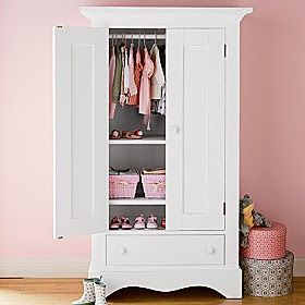 I would love an armoire like this for storing extra pillows and blankets
