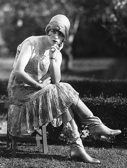 Flapper - Flappers were the new age women of the 1920s and were free of previous restrictions placed on females; they drank, smoked, kissed, went out to clubs, and drastically changed their hair and clothing.