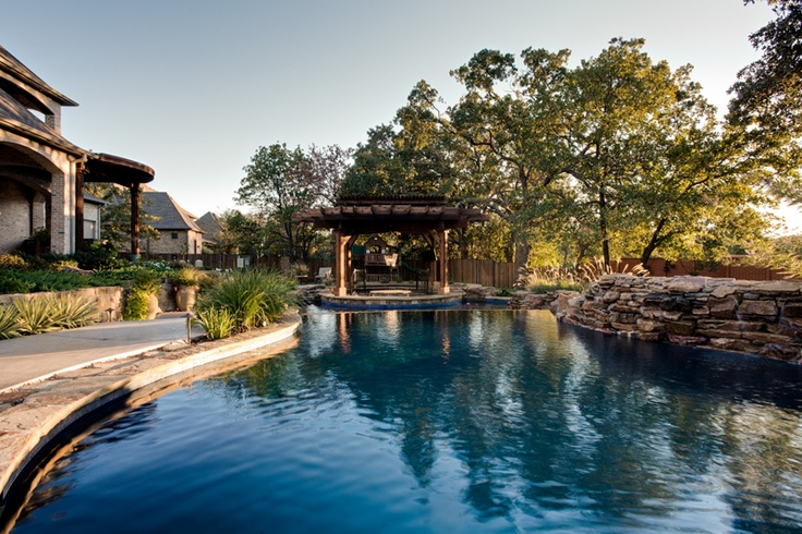 Custom natural diving pool with rock waterfalls and for Luxury pools with waterfalls