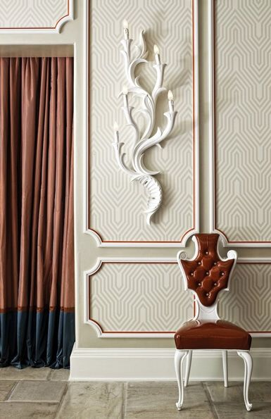 I love the wallpaper with the picture frame molding!