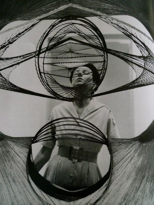 Peggy Guggenheim seem through a Pevsner sculpture
