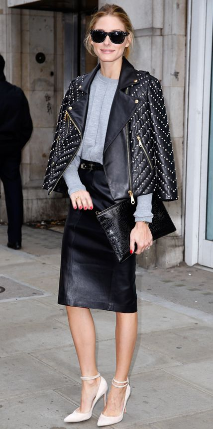 Olivia Palermo found middle ground between too-cool tough and ladylike sophistication with a gray knit that she tucked into a leather pencil skirt, complete with a studded moto jacket draped over her shoulders, a black croc pouch, studded shades, and nude ankle-strap pumps. #InStyle